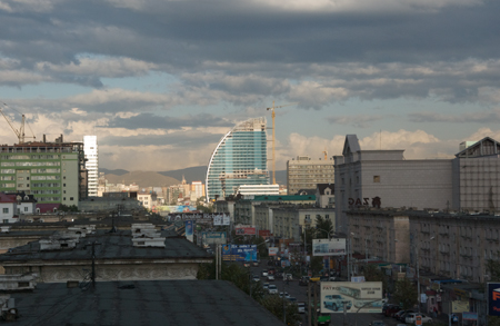 Ulaanbaatar skyline along Peace Ave., with new office building under contruction