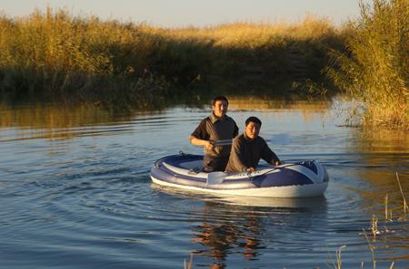 Rubber boat, Khar Us Nur National Park, western Mongolia