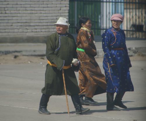 Three Mongols wearing del; train station, April 2005