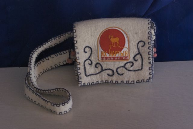 A felt purse with Ikh Nart patch which was given to me as a gift