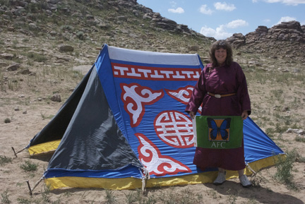 "A ""maikhant"" or summer tent; me in my new del with the AFC Flag"