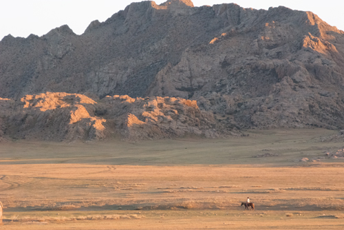 Horse and rider, early evening, Baga Gazriin Chuluu Nature Reserve