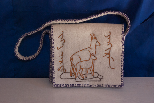 Ibex purse custom made for a Chinese researcher studying argali; i did the drawing on the felt