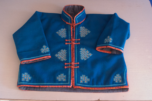 One woman also brought this child's khurem, or jacket, that she made, wanting to sell it because it was too big.