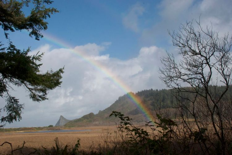 Rainbow at Dry Lagoon State Park with Goat Rock in the background.