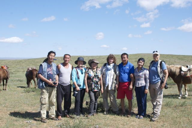 Expedition members and staff, from left to right: Oidoviin Magvandorj (Mongol artist), Sendag (driver), Odna Idevkhen (Mongol photographer), Tugsoyun Sodnom (Mongol artist), Susan Fox (American artist), Batmaa (driver), Tseegii (guide), Sharon K. Schafer (American artist); photo by Soyoloo our great cook