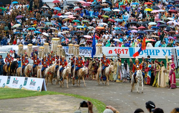 Procession into the naadam stadium with the official State horsetail standards