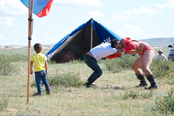 The wrestlers in the traditional garb are more experienced and have probably earned rankings in the soum or aimag. Any local guy can enter and see what he can do.