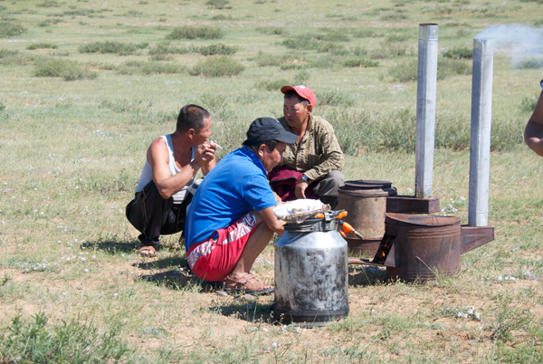 Our drivers, Batmaa and Sendag, helped with the real Mongolian BBQ....khorhog (mutton or goat cooked in the metal containers)