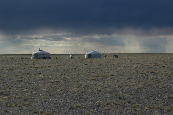 Reaching the Gobi, we saw the occasional ger. There was rain across a wide swath of the horizon.