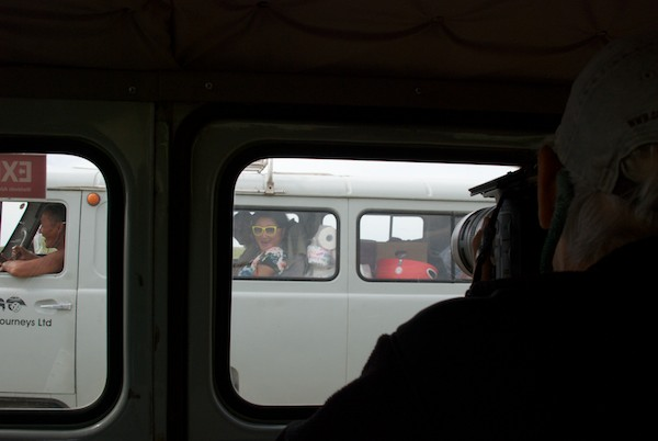 Sharon takes a photo of Tugs-Oyun, who is riding in the other van
