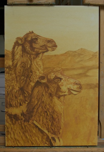 The next step is to bring up the dark values of the camels, referring to my drawing as needed.
