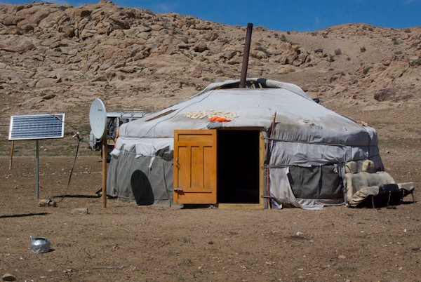 """We came to this ger in a sheltered area, after stopping at a very small settlement where the drivers had asked directions. Apparently they were told that this was THE place to stop because we could get very good """"tsagaan idee""""/white food, meaning the summer dairy products. They were right."""