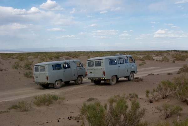We came to a sand dune area and got out to poke around and take a break. Here's our faithful Russian vans.