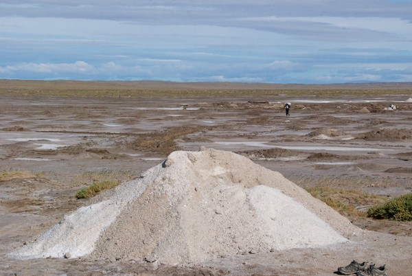 The salt deposit, with harvested salt ready to be bagged up.