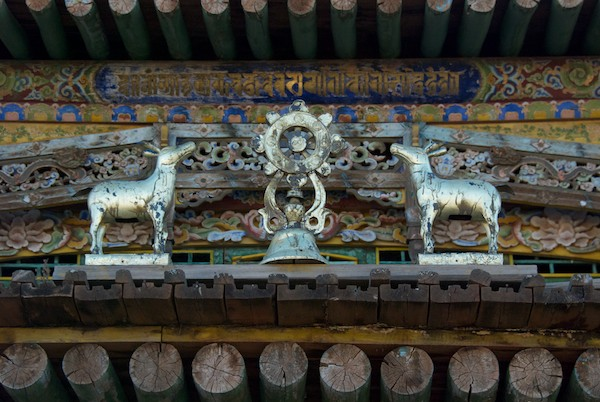 Buddhist symbol set of deer and wheel over door