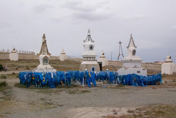 Stupas and khadag near the temple.