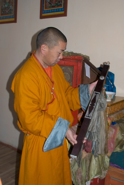Monk showing us a ceremonial staff.