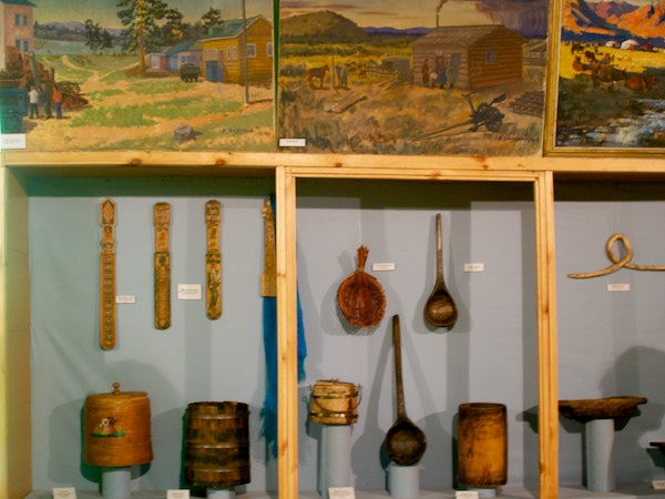 It was hard to get back far enough to get everything in, but here is one of the display cases with everyday utensils. There was art all around the room, too.