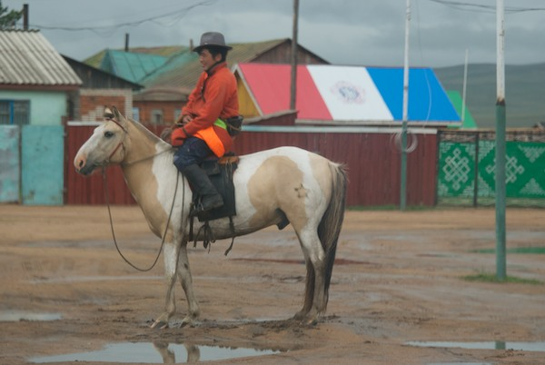 After breaking camp we went into the soum center to go to the store. I stayed in the car and got some great photos of this local horseman.