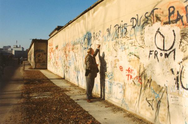 Mu husband, David, writing on the Wall.