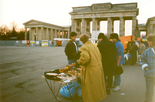 Street vendor with the Brandenburg Gate in the background.