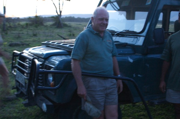 Simon Combes posing by one of the Land Rovers