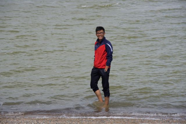 "Turuu wading at the ""beach"" on the east shore of Khar Us Nuur; he's a student I met last year who is quite a good artist and he came along on the first two weeks of the Expedition at my invitation"