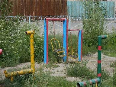 Playground metal pipe snakes; Bayan-Ulgii, western Mongolia 2015