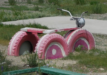 Playground tricycle made from old tires; Bayan-Ulgii, western Mongolia, 2015