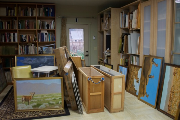 Paintings and crates in my studio