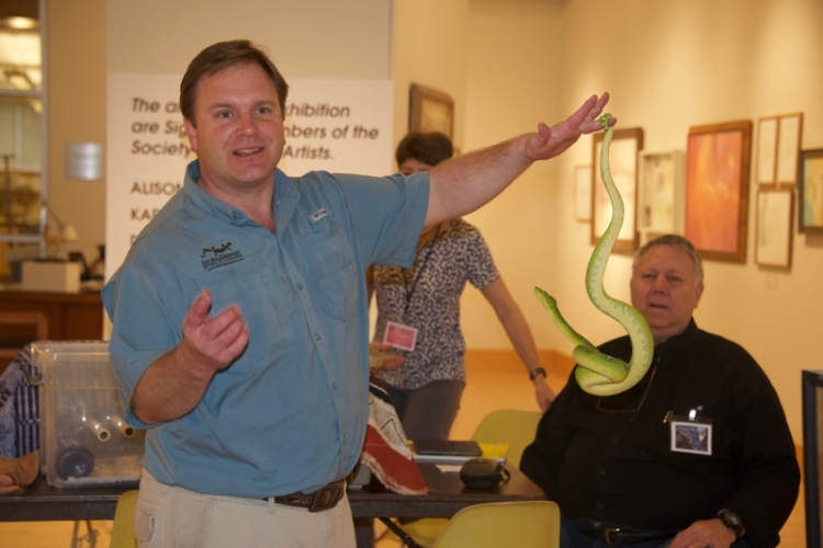 Chris Evers of Animal Embassy and green tree snake