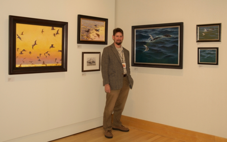 Sean Murtha with some of his work