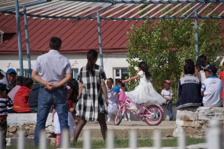 32. girl on bike