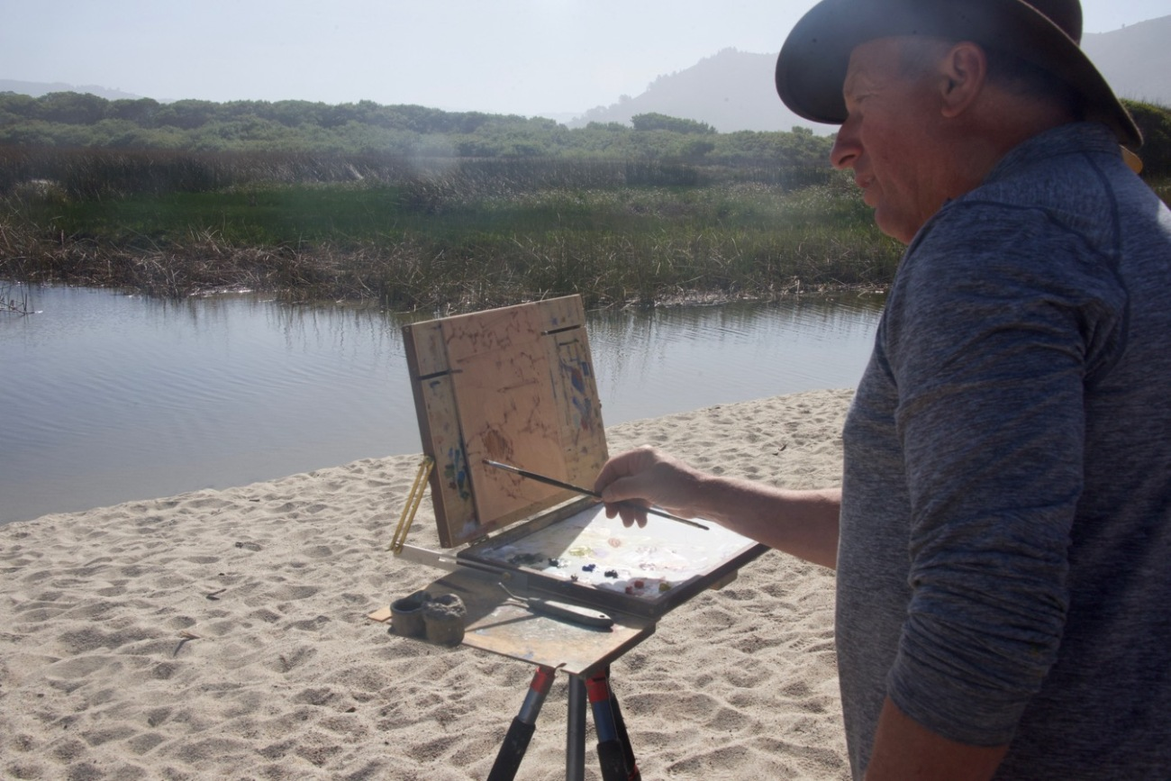 "Paul uses an Open Box M that is mounted on a camera tripod. He starts with an indication brush drawing of the main shapes using a brush called a ""bright"". It's shorter than a flat which is a, well, flat rectangle. He moved his hand in sharp, short strokes"